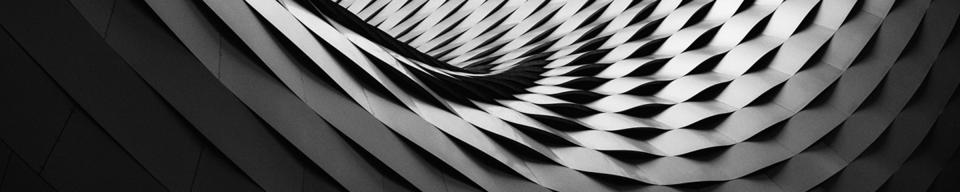 Curved black and grey roof tile structure